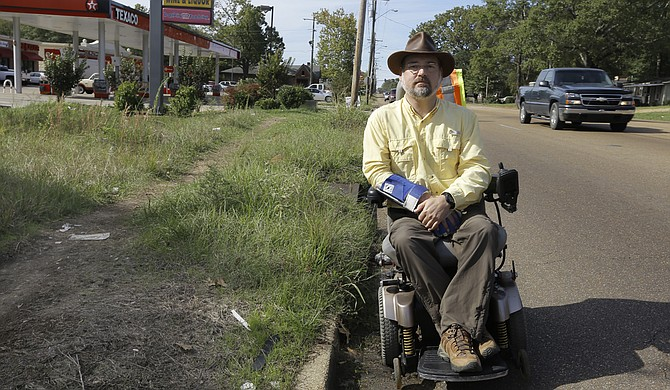Scott Crawford says his Fondren neighborhood is full of danger for people in wheelchairs, those with visual impairments and gait disorders.
