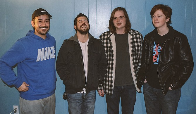 (Left to right) Tommy Bobo, Cody Sparkman, Reed Smith and Dean Harrison of Fides perform Friday, Dec. 4, at Martin's Restaurant & Bar. Photo courtesy Fides