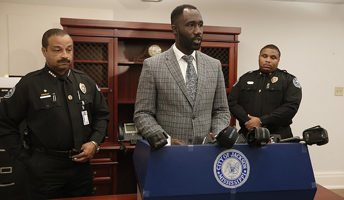The City of Jackson announced several more firings of workers, and up to two arrests, for water-related theft on Dec. 18. Mayor Tony Yarber (center) announced arrests of two public-works employees earlier in the week. Chief Lee Vance (far left) commended Commander Tyrone Buckley (far right) and Sgt. Obie Wells (not pictured) for leading the investigation.