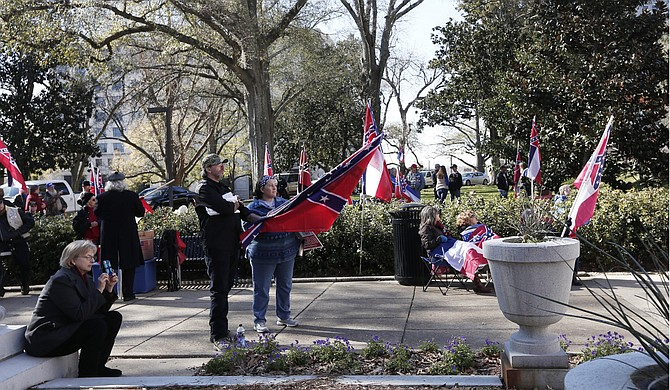 "Several pro-state-flag organizations including the Magnolia State Heritage Campaign and the Dixie Alliance held a rally outside the capitol on Jan. 19 to ""save the state flag."""