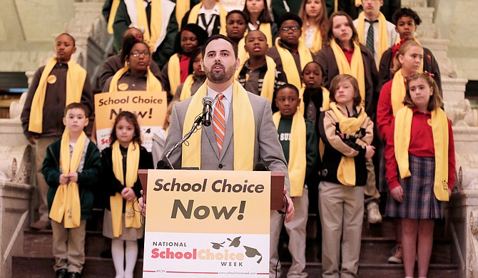 Grant Callen, president of Empower MS and a strong supporter of vouchers and charter schools, speaks to the crowd gathered at the Capitol for the National School Choice Week rally on Tuesday.