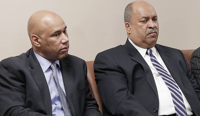 Leroy C. Smith (right) says he can finish Phase I of his plan for developing Farish Street by the fall. Pictured on the left is Harvey Freelon, an attorney who owns a popular nightclub and restaurant on Mill Street.