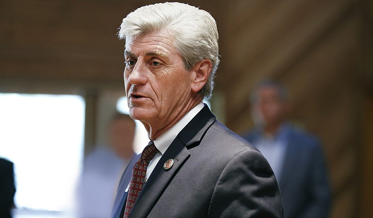 """Gov. Phil Bryant (pictured) would get to appoint five commissioners of the new airport authority if the """"takeover"""" bill authored by Sen. Josh Harkins, R-Flowood, becomes law."""