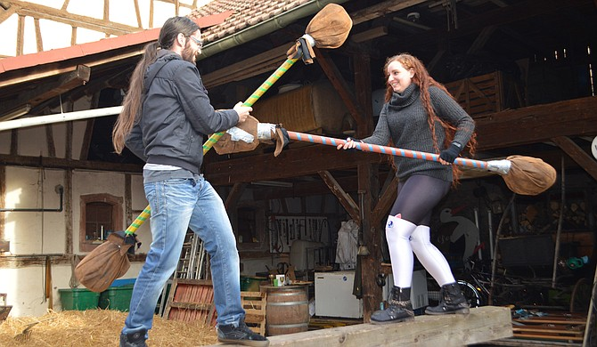 Alexandre (left) and Heather Berthereau (right) play with pugil sticks at a medieval festival. Photo courtesy Richard Coupe