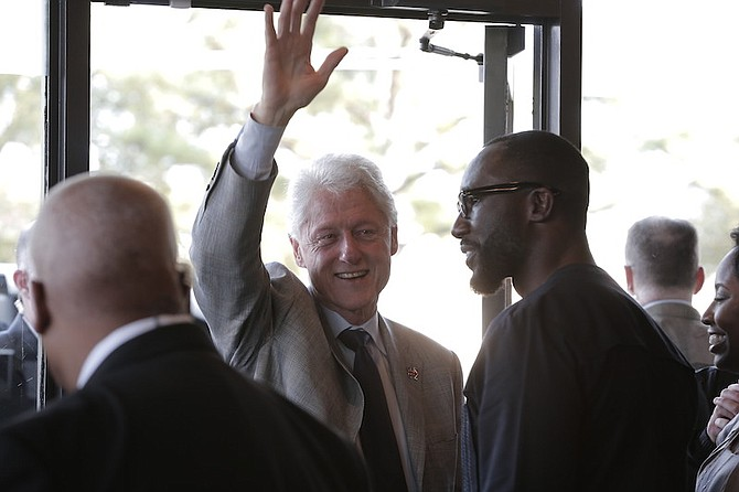 Former President Bill Clinton was greeted by Jackson Mayor Tony Yarber upon his arrival at Cups coffeehouse in Jackson's Fondren neighborhood.