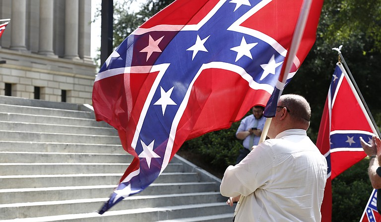 Mississippi is the last state with a flag that includes the Confederate battle emblem—a red field topped by a blue X dotted with 13 white stars.