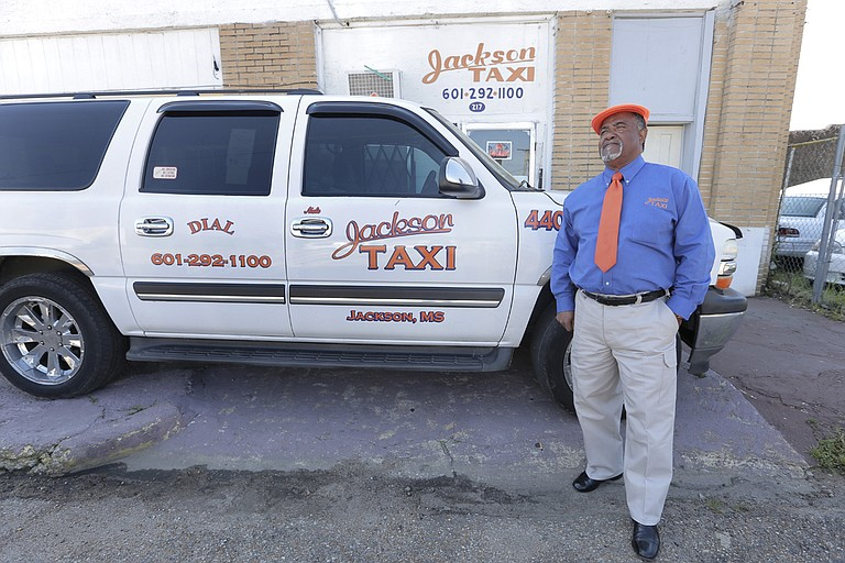 """Nate Johnson, a 40-year taxi driver and manager at Jackson Taxi, said that many people don't know what taxi drivers face here. """"They just think that we are charging too much, which really we are not,"""" he said."""