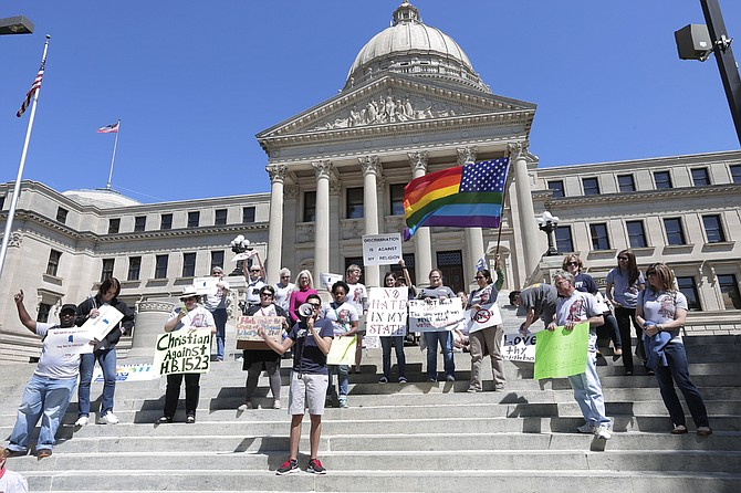 Protestors gather on the steps of the Capitol to rally against the passage of HB 1523, which would make discriminating against the LGBTQIA community legal.