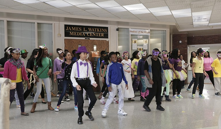 Northwest IB Middle School students dance to Mardi Gras music.