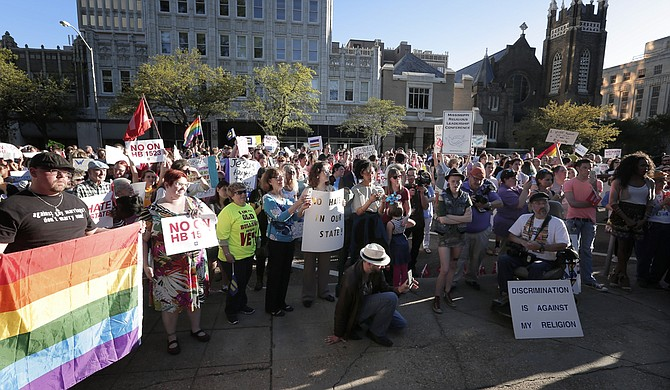 Protesters rallied against HB 1523 on Monday, April 4, outside Gov. Phil Bryant's mansion, right after the House of Representatives sent the bill to the governor.
