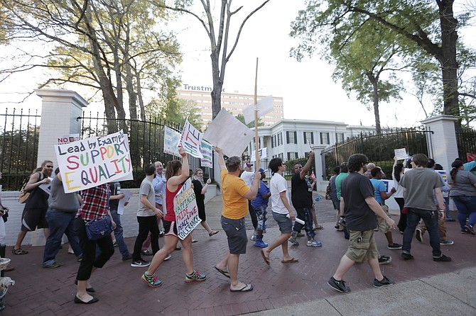 Protesters marched around Gov. Phil Bryant's mansion in protest to House Bill 1523 on Monday,  April 4, a day before the governor signed the anti-LGBT bill into law.