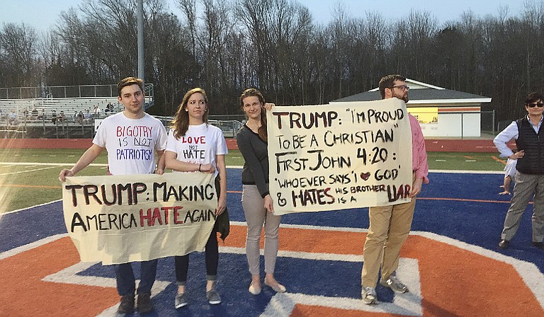 Protesters gathered outside of Madison Central High School at Donald Trump's March 7 rally. Photo courtesy Onelia Hawa