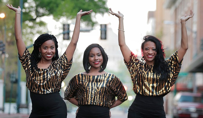 (Left to right) Amira Carey, Elisha Roberts and Monica T. Shepherd perform as Motown-inspired singing trio Love Notez.