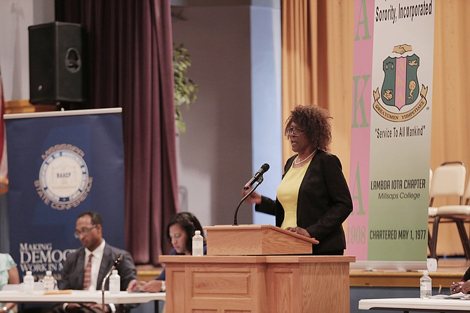 "JMAA Commissioner Evelyn Reed promised litigation and FAA intervention over the state airport ""takeover"" during an April 21 NAACP public meeting."