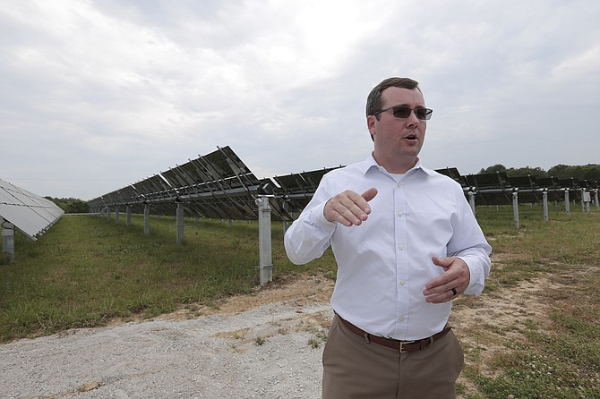 Aaron Hill, manager of transmission planning at Entergy's solar plant in Hinds County, shows off the panels, which are on a tracking system to follow the Sun.
