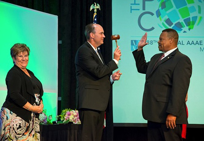 Carl Newman, executive director of the Jackson Medgar-Wiley Evers International Airport, receives the gavel from previous head of the American Association of Airport Executives, Jeff Mulder from Tulsa, Okla. Photo courtesy JMAA