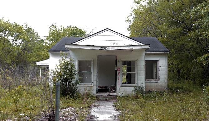 This house on Wainwright Street, like more than 3,000 other properties across Jackson, is owned by the State of Mississippi. It was forfeited in 2012 after owners accumulated four years of unpaid property taxes.