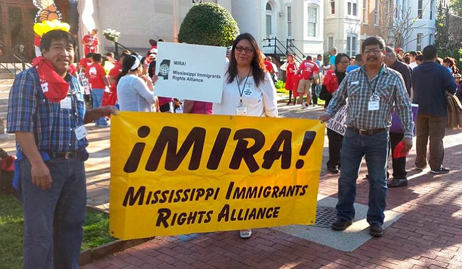 Jesus Mateos Ramirez (left), Melinda Medina (center) and Esequiel Gamboa (right) attend a rally for Immigrants Rights. Medina is the co-owner of the Gulf Coast Latino Services and a community organizer with MIRA. Photo courtesy Melinda Medina