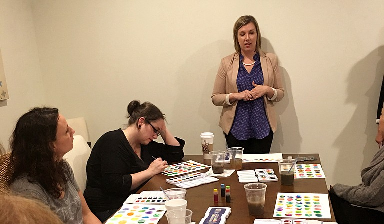 Earlier this year, counselor Megan Clapton and artist Ginger Williams Cook (pictured) partnered together for a workshop that combined mindfulness practices and watercolor painting. Photo courtesy Ginger Williams Cook