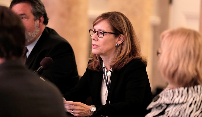Dr. Mary Currier, the state's public health officer, told members of the Legislative Black Caucus, that her department will have to send more people home due to fiscal year 2017 budget cuts.