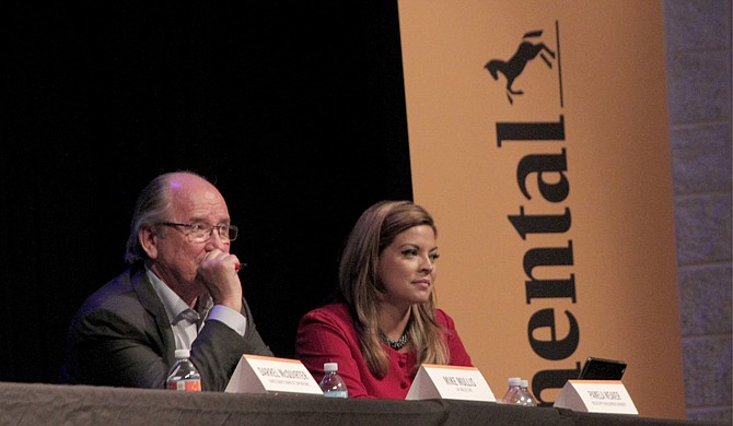 Memphis-based Project Specialist Mike Mullis (left) and MDA Chief Marketing Officer Pamela Weaver (right) listen to audience questions at the June 21 Continental Tire town-hall meeting.