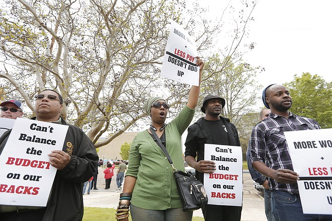 City workers and community activists protested furloughs on April 1, 2016, for municipal employees, which Council President Melvin Priester believes will be in place through next year's budget. File Photo