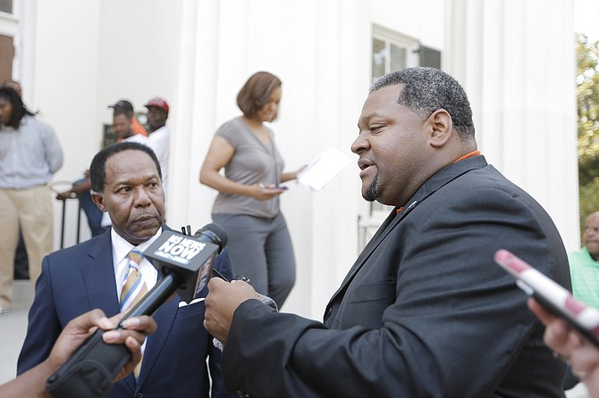 MAC and Associates, LLC, wants to keep its lawsuit against Siemens Industry Inc., in the Hinds County Circuit Court rather than in federal court. Jackson attorney Robert Gibbs (left) is represented owner Marcus Wallace (right) in the case.