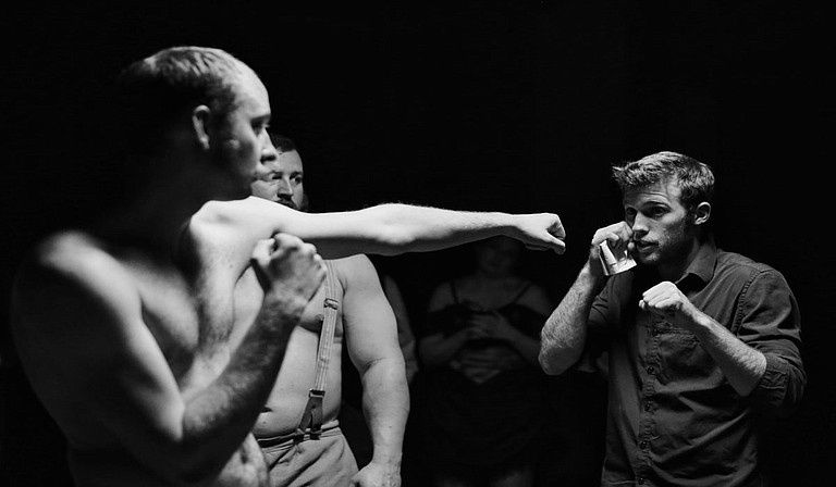 "Joshua Powell (front left), who plays The Boxer in the film ""Bare Knuckle,"" rehearses stunt choreography with the film's stunt coordinator, Jacob Pattison (right), as Lance Barrett (back left), who plays Bruiser in the film, looks on."