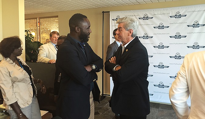 "Jackson Mayor Tony Yarber (left) and Gov. Phil Bryant (right) both mentioned the ""momentum"" that the addition of a new air service to the Jackson-Medgar Wiley Evers International Airport means to the Jackson metro area."