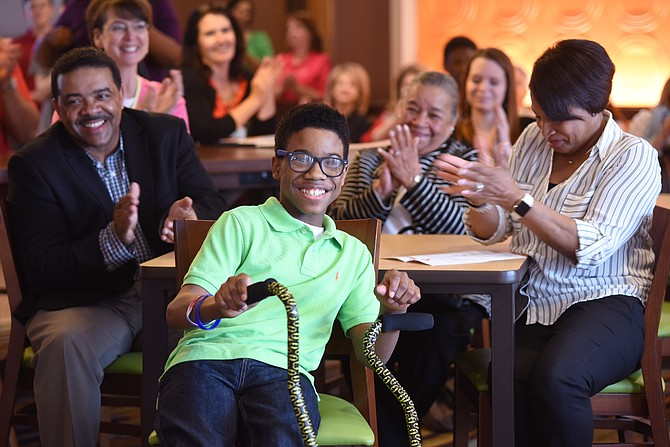 Jordan Morgan smiles as he is announced as the 2016-17 Children's Miracle Network Hospitals Champion for Mississippi on Wednesday in Clinton. Cheering him on are, from left, father Chris Morgan, grandmother Evelyn Morgan and mother Deborah Morgan. Photo Courtesy University of Mississippi Medical Center