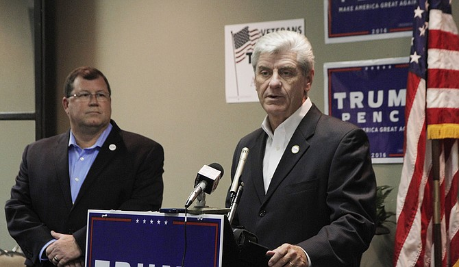 Gov. Phil Bryant told reporters he has a problem with universities taking down the Mississippi state flag because it sends the message to students that universities can ignore the state code.