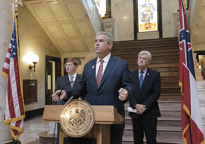 In July, the state's top leaders, Lt. Gov. Tate Reeves (left), House Speaker Philip Gunn (middle) and Gov. Phil Bryant (right) announced the creation of a tax-policy panel to evaluate the state's tax structure; the panel met Sept. 1 to listen to a Tax Foundation economist's outlook of the state's tax structure.