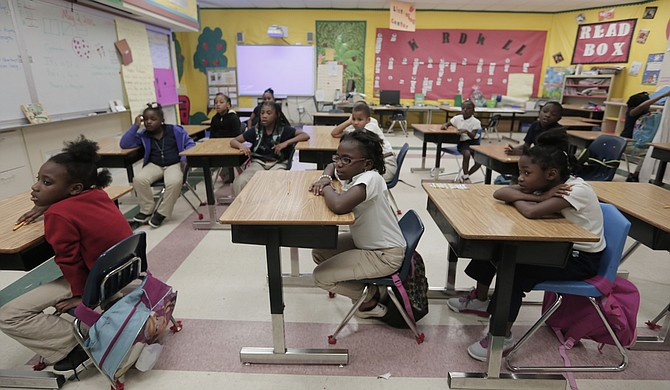Galloway Elementary School students pay attention to their teacher during afterschool with Operation Shoestring.