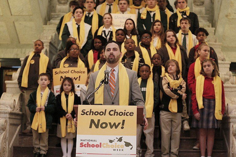 "Grant Callen, president of ""school choice"" advocacy group Empower Mississippi, speaks before a crowd at the Capitol at the beginning of National School Choice Week in February."