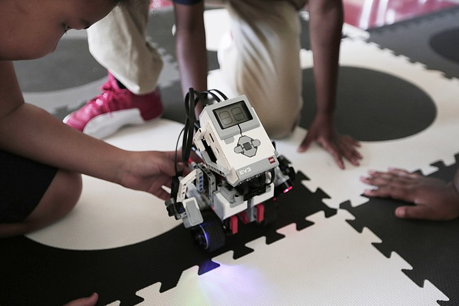 Students show off robots and other technology they helped build after school at Brown Elementary.