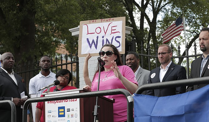 Felicia Brown-Williams (center), the public policy director at Planned Parenthood Southeast, said she knew a federal-court challenge would strike down a new State law targeting the clinic.