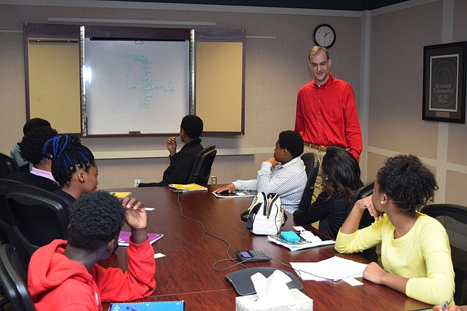 Provine High School students in the Business and Finance Academy listen to Hope Credit Union's chief financial officer, Richard Campbell, talk about how credit unions work. Photo courtesy Hope Credit Union