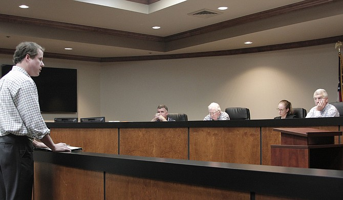 Pearl River Vision Foundation representative Dallas Quinn outlines the next steps in the One Lake project, including meetings with Rankin and Hinds County supervisors, to the Levee Board Monday.