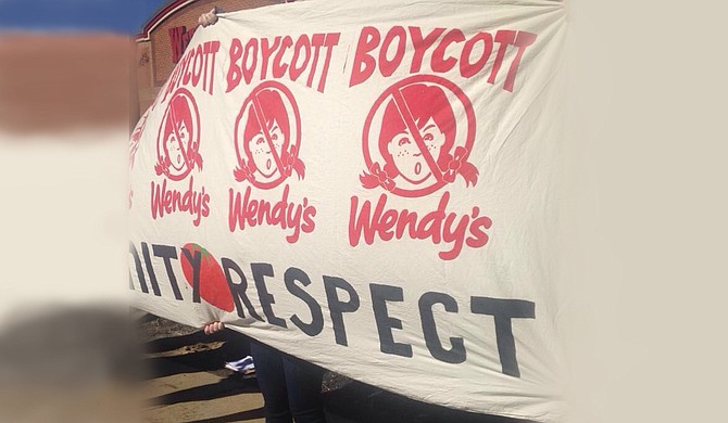 Protesters gathered at a local Wendy's this weekend to protest the restaurant for not participating in the Fair Food Program.
