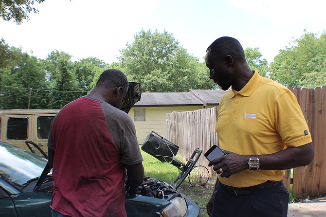 Mayor Tony Yarber peeks under the hood of his 1992 Mitsubishi Mighty Max truck that his family still owns in Subdivision 2 in west Jackson. Photo courtesy Eli Bettiga
