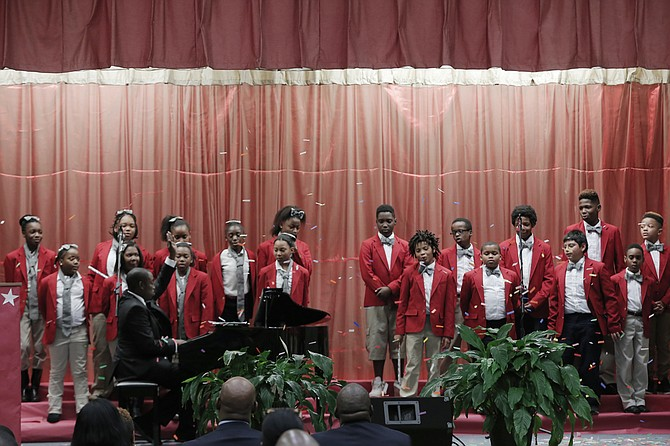 The Baker Bulldogs choir sings to welcome guests to their school.