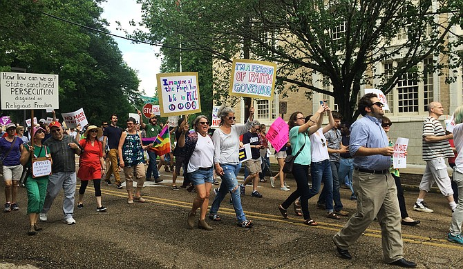 Protesters marched from the Capitol to the governor's mansion on May 1, 2016, in protest of Gov. Phil Bryant signing House Bill 1523 into law.