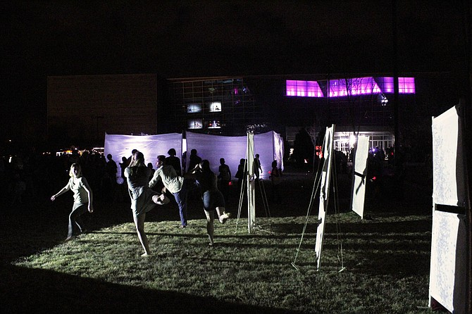 Dancers from Kinetic Etchings do a light dance at the Mississippi Light Festival on Feb. 24, 2017.