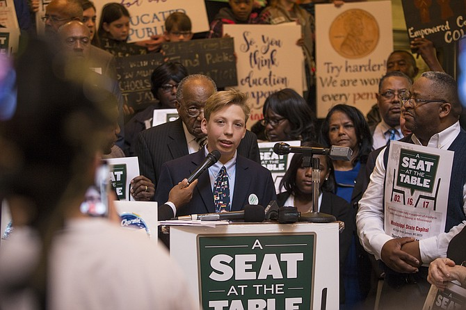 "J.T. Grist, an eighth-grade student at Tupelo Middle School, spoke at the ""Seat at the Table"" rally on Thursday, March 16, saying all students deserve good schools, no matter where they live."