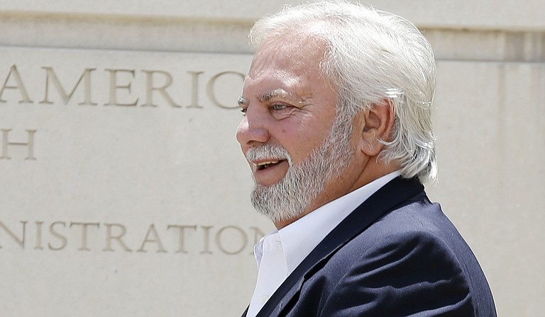 Cecil McCrory, a businessman who bribed Mississippi's former prisons chief, will only have to pay a $20,000 fine, not the $150,000 originally imposed, after he testified Wednesday that his debts outweigh his assets. Photo courtesy AP/Rogelio V Solis