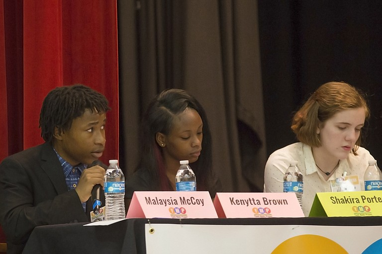 Kenytta Brown of Lanier High School (left),  Shakira Porter of Wingfield High School (middle) and Maggie Jefferis of Murrah High School (right) questioned mayoral candidates at Provine High School on Monday night as part of the Youth Media Project student media panel. Not pictured: Dartavius Archie.