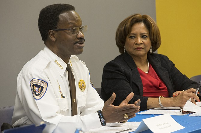 Hinds County Sheriff Victor Mason (left) and Supervisor Peggy Calhoun (right) discuss the importance of mental-health services and diversion programs for Hinds County residents entering the criminal-justice system.