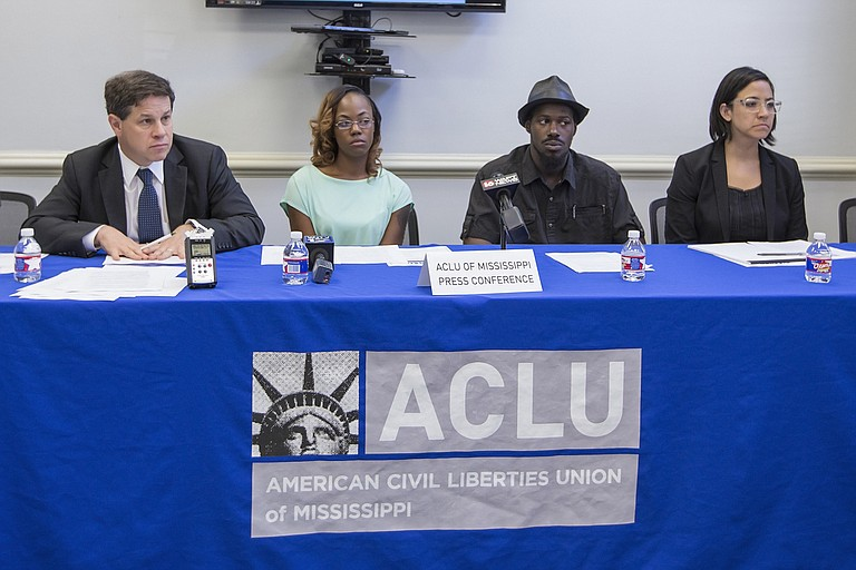 Jonathan Youngwood, attorney at Simpson Thacher & Bartlett (left), plaintiffs Quinnetta Manning and Steven Smith (middle) and ACLU of Mississippi Legal Director Paloma Wu (right) take questions from the press after filing a federal class-action lawsuit against Madison County and Sheriff Randall Tucker.