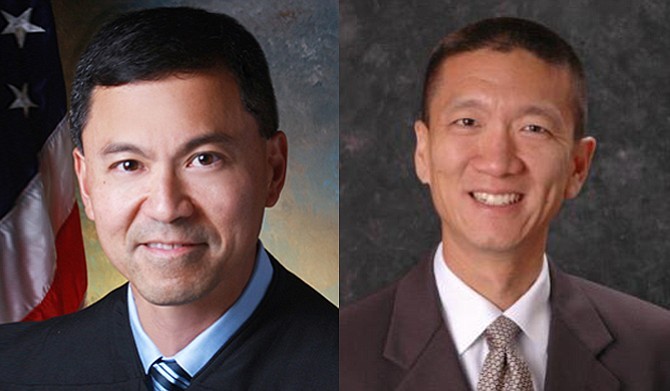 "In March, U.S. District Judge Derrick Watson (left) in Honolulu blocked the new version of Trump's travel ban from taking effect, citing what he called ""significant and unrebutted evidence of religious animus"" in Trump's campaign statements. Hawaii Attorney General Douglas Chin (right) wrote to the 9th Circuit that ""the President claims a nearly limitless power to make immigration policy that is all but immune from judicial review"" and ""he must be checked."" Photo courtesy US Courts State of Hawaii"