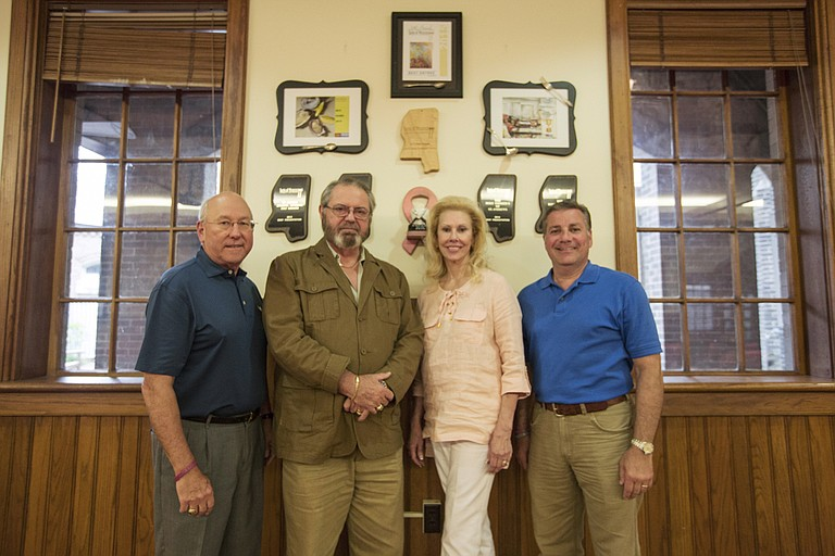 From left: Bill Howard, Mike Flannes, Dawn Flannes and Joe Surkin are members of the Holy Smokers, which is a culinary group based out of St. Andrew's Cathedral in downtown Jackson.